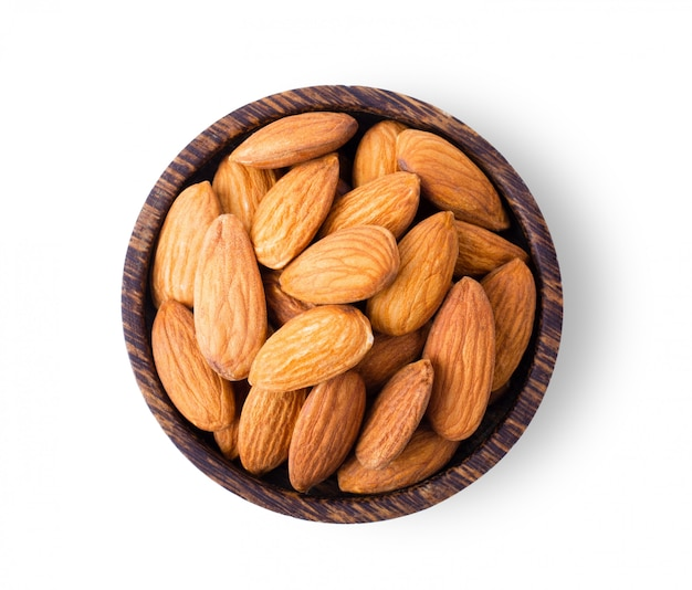 Almond nuts in wood bowl isolated