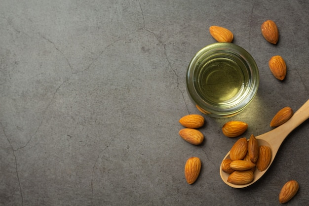 Almond oil in bottle on dark background