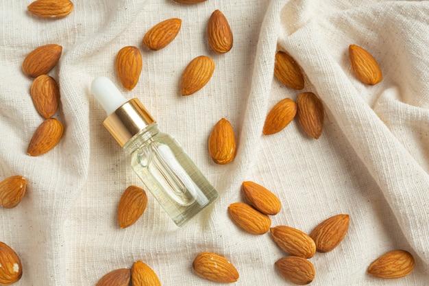 Almond oil in bottle on white background