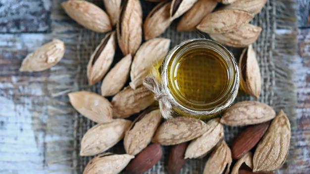 Almond oil in a jar almonds in shells