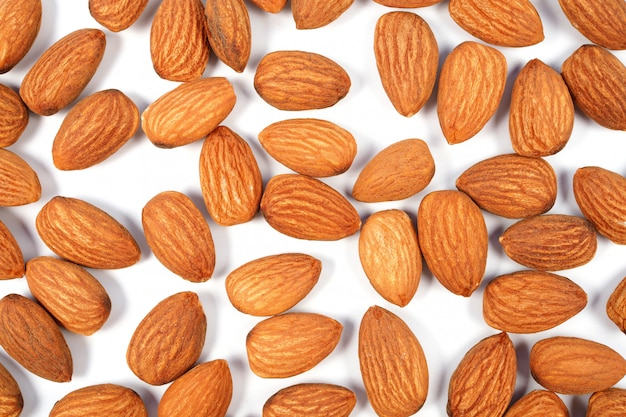 Almond seeds isolated on white background. top view