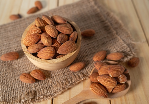 Almond snack fruit in wooden bowl on wooden