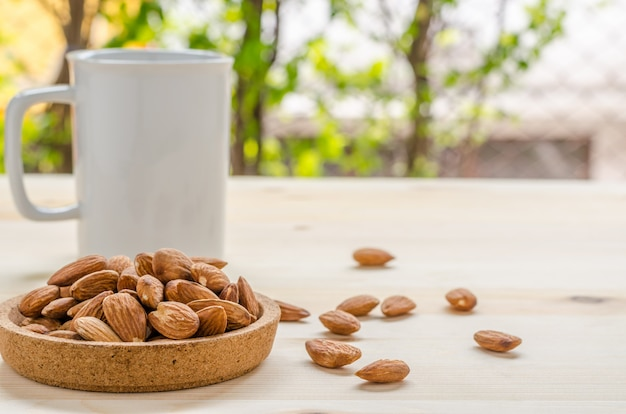 Almond snack on wooden table: breaking time in office
