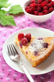 Almond tart with raspberries and white chocolate