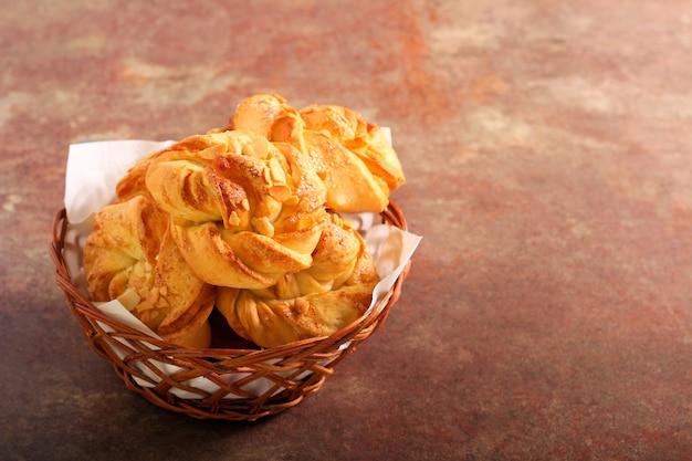 Almond twist buns in a basket