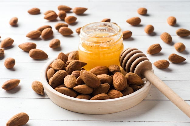 Almonds and a can of honey on the table.