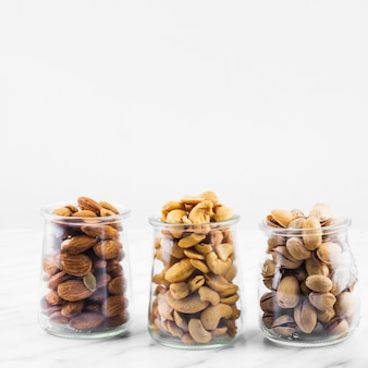 Almonds; cashewnuts and pistachios on marble backdrop