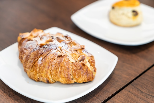 Almonds croissants on plate