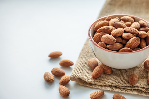Almonds in cup on sack