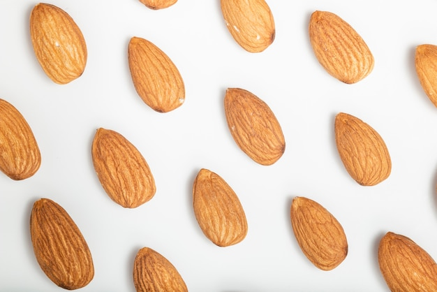 Almonds flat lay pattern. white background. top view.
