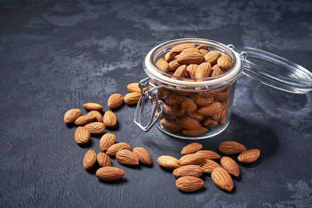 Almonds  in the glass jar, close-up ,top view