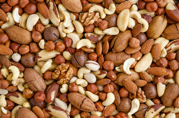 Almonds, hazelnuts, cashews, brazilian nuts, walnut, macadamia, pecans and pistachios mixed together. natural background. healthy food. top view.