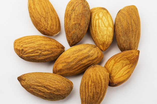 Almonds isolated on white background, close-up
