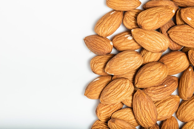 Almonds isolated on white background. top view. macro photography.
