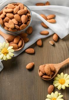 Almonds nuts   peeled on wood spoon on wood table background.