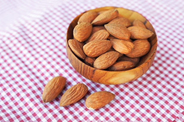 Almonds nuts in wooden bowls. selective focus