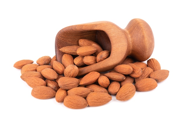 Almonds nuts in wooden scoop, isolated on white background.