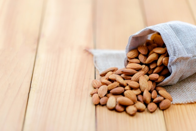 Almonds pour from bag