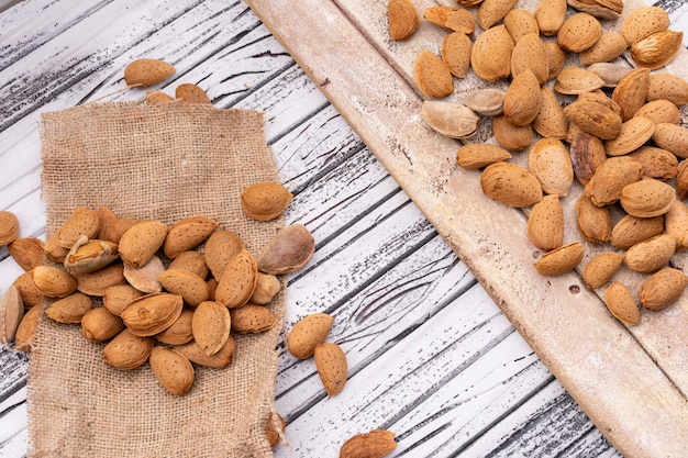 Almonds on sacking and wooden board