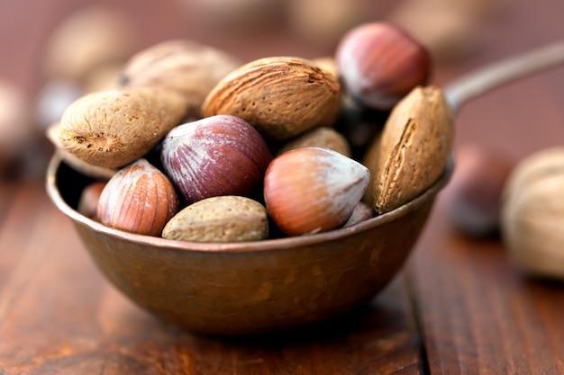 Almonds, walnuts and hazelnuts in metallic bowl