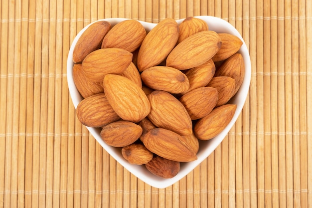 Almonds on wooden background. healty food concept.