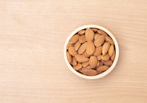 Almonds on a wooden background