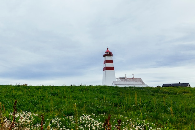Alnes lighthouse at godoy island near alesund; norway