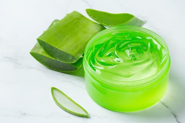 Aloe vera cosmetic cream on white surface