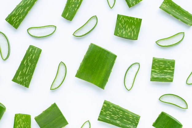 Aloe vera cut pieces with slices on white background.