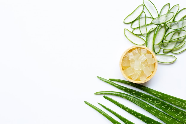 Aloe vera is a popular medicinal plant for health and beauty, white background.