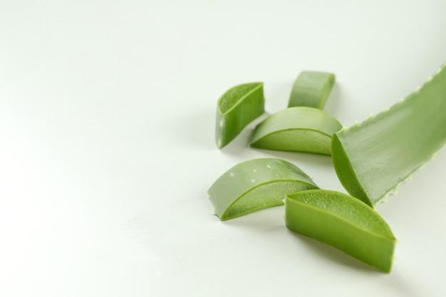 Aloe vera leaf and slices on white background