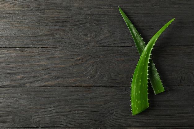 Aloe vera leaves on wooden table