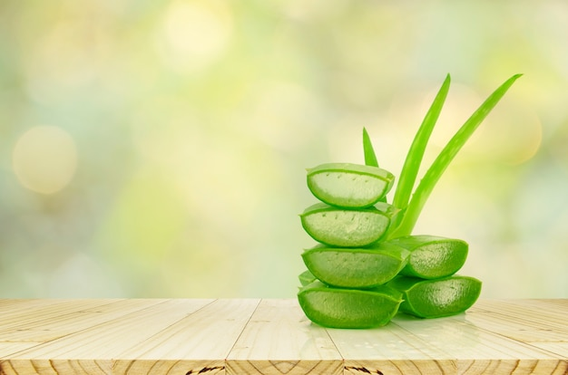 Aloe vera on product display wood counter background.