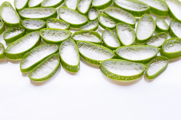 Aloe vera slices on white background