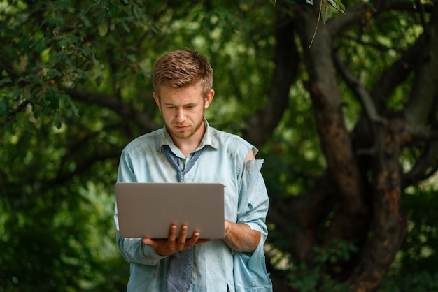 Alone businessman with laptop on desert island