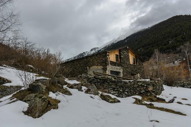 Alone cabin in the snow