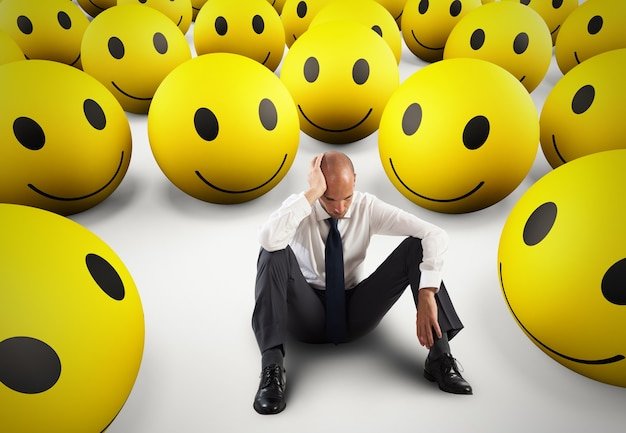 Alone desperate businessman in the middle of happy smileys  d rendering