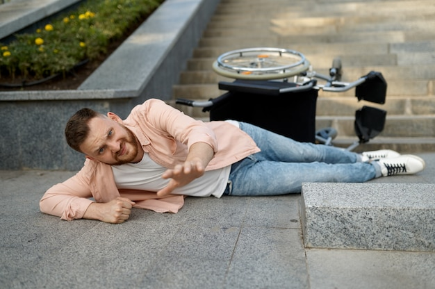 Alone disabled man fell out of a wheelchair