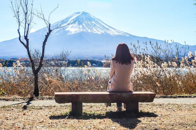 Alone girl on chair see view sightseeing fuji mountain lake views