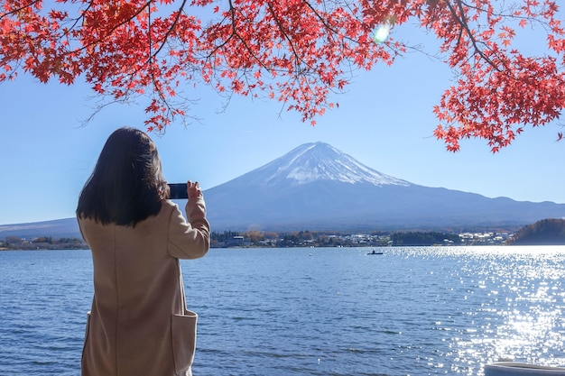Alone girl takephoto fuji mountain lake views