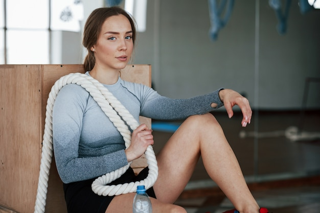 Alone in the room. sportive young woman have fitness day in the gym at morning time