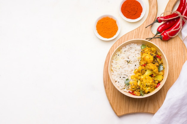 Aloo gobi indian vegetarian vegetable dish on wooden