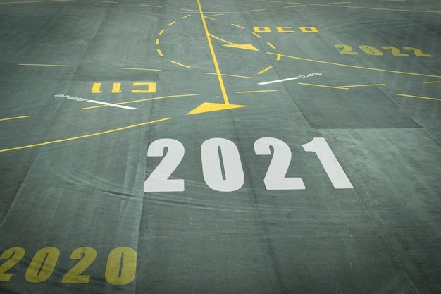 Alphabet 2021 on the airport runway floor, concept for new year's day