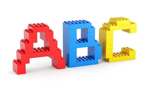 Буквы алфавита abc из игрушечных строительных блоков, изолированные на белом фоне. вернуться к концепции школы и образования.