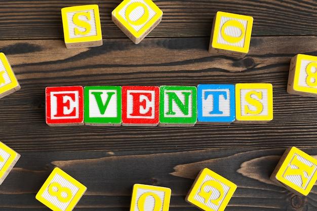 Alphabet blocks abc on wooden table. text - events