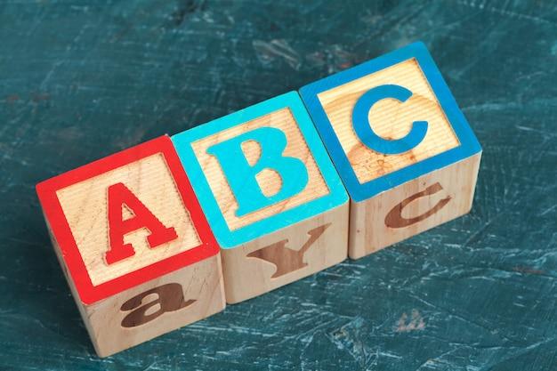 Alphabet blocks abc on wooden table