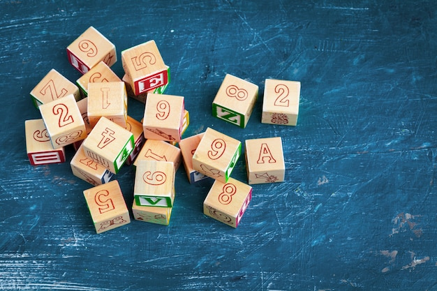 Alphabet blocks abc on wooden table.