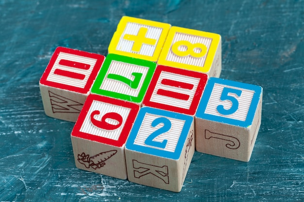 Alphabet blocks on wooden table.