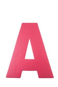 白い背景の上のアルファベットフォームカラフルなパズルのピース。