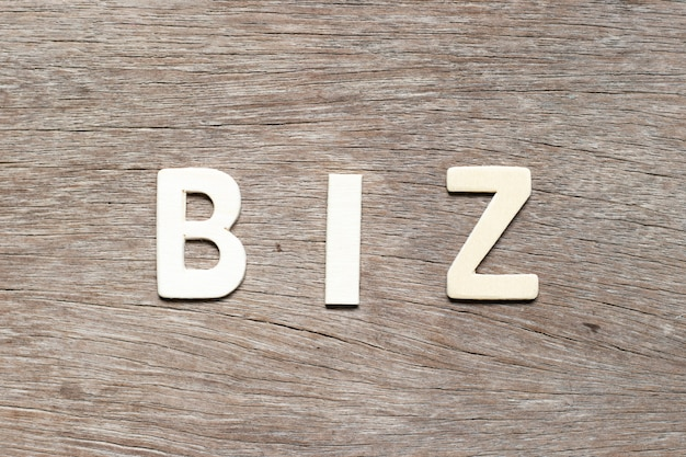 Alphabet letter in word biz (abbreviation of business) on wood